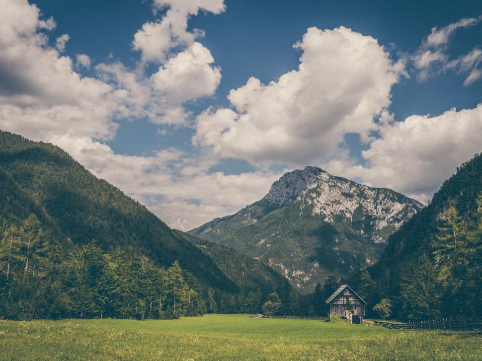 Download Free Stock Photo of Buildings Nature mountain highland landscape mountains sky range grassland grass travel summer rock clouds hill valley trees rural scenery peak scenic hills tourism snow outdoors field forest