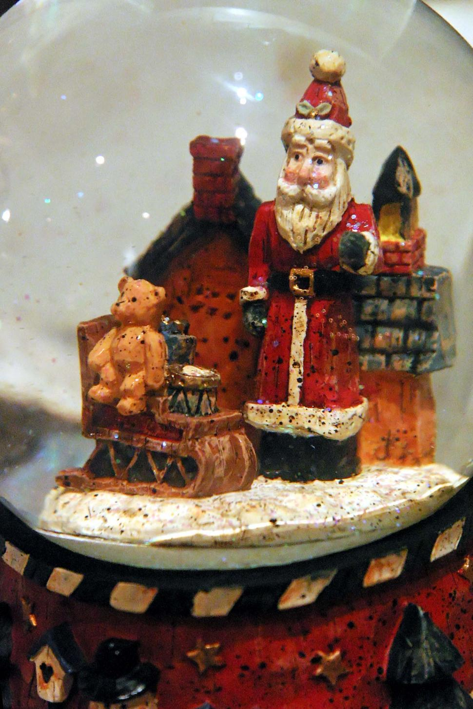 Download Free Stock Photo of christmas holiday holidays decoration claus santa toy doll figurine figure snow globe