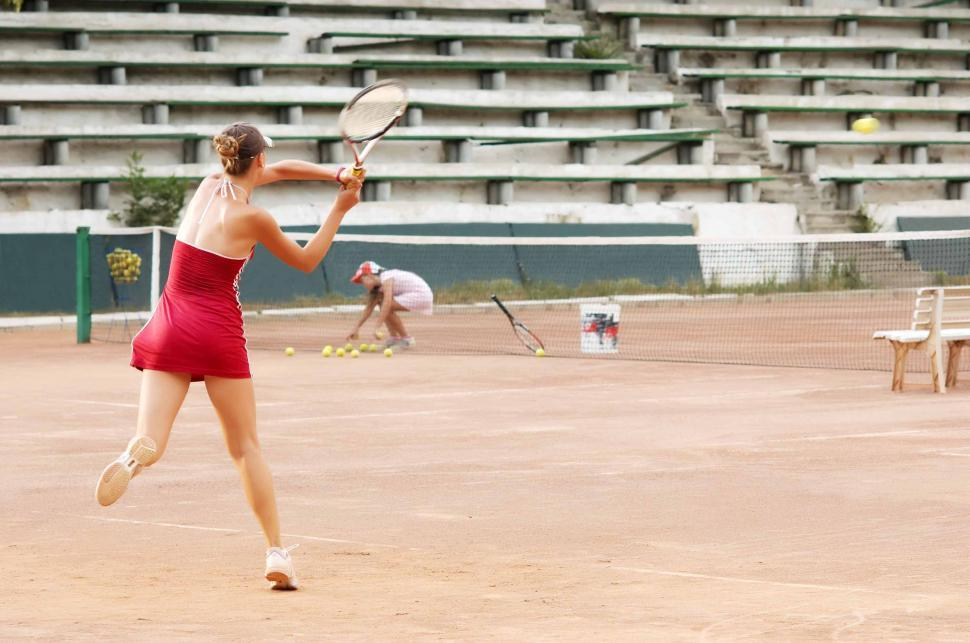 Download Free Stock HD Photo of blond girl playing tennis Online