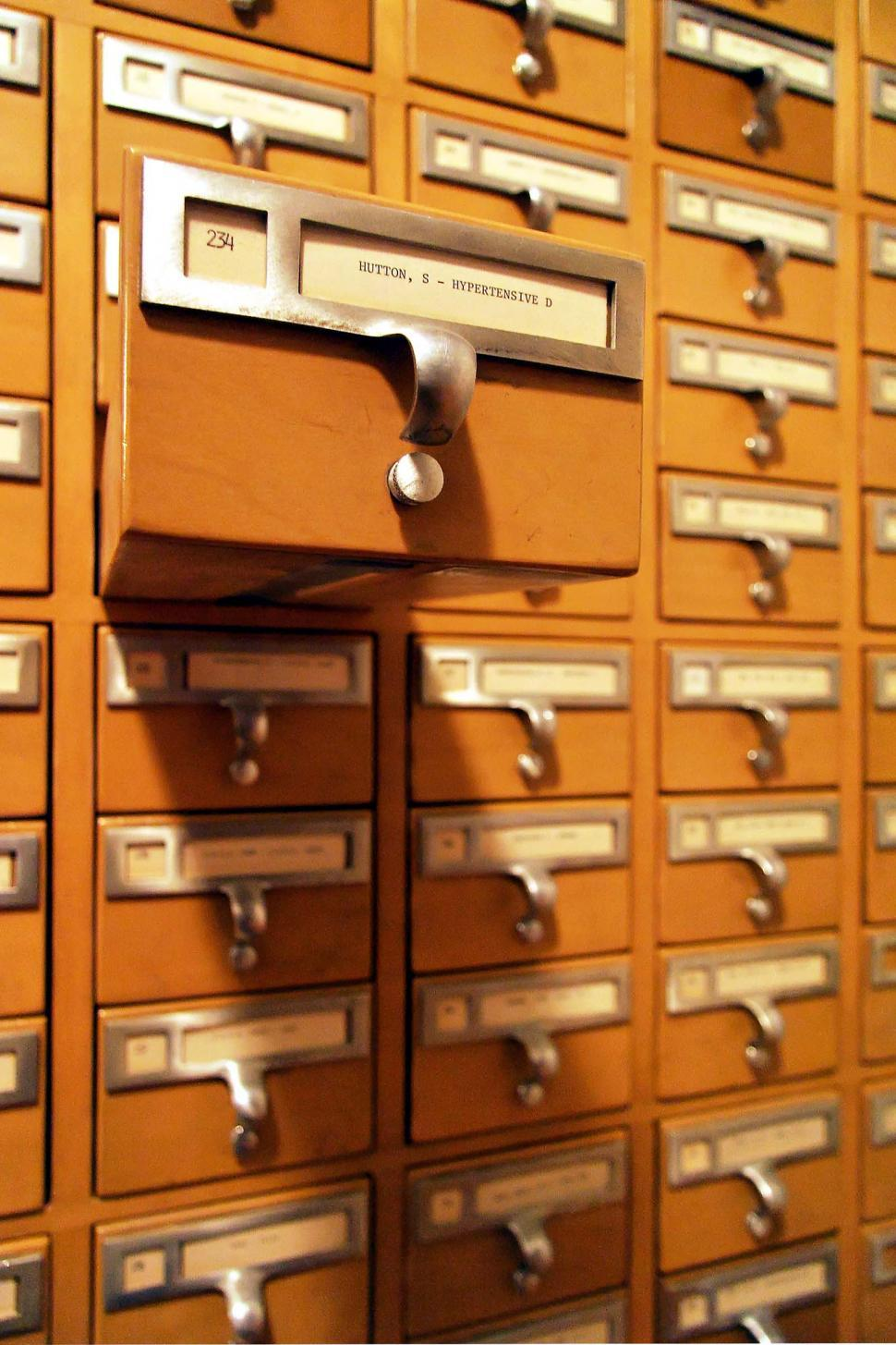 Download Free Stock Photo of card catalogue catalog drawers organization organized labels index cards handles pulls library furniture information hypertensive