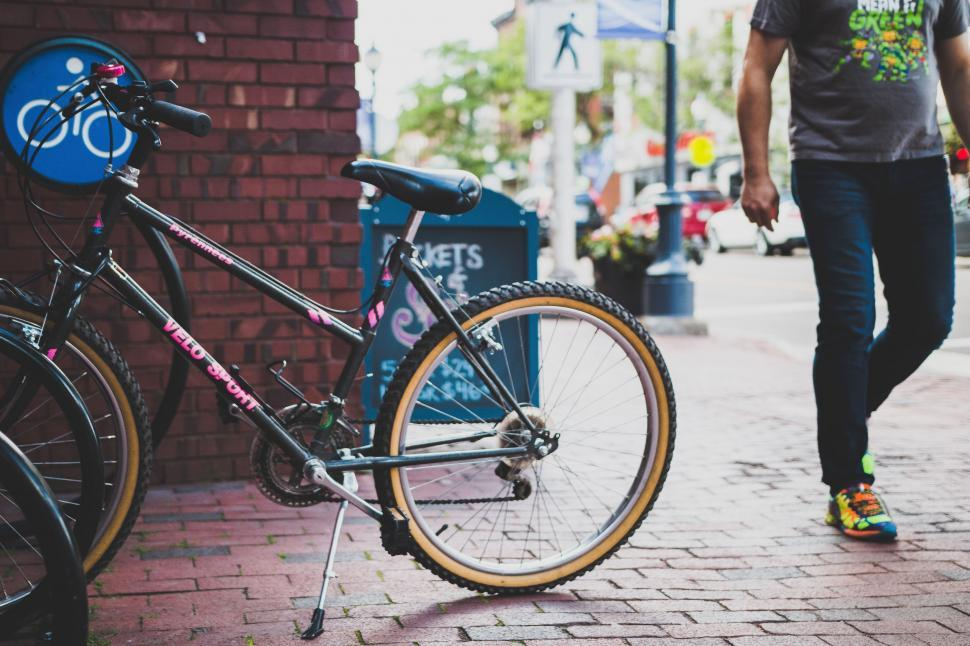 Download Free Stock Photo of Buildings Objects People bicycle wheeled vehicle vehicle tricycle bike jinrikisha wheelchair wheel chair cart