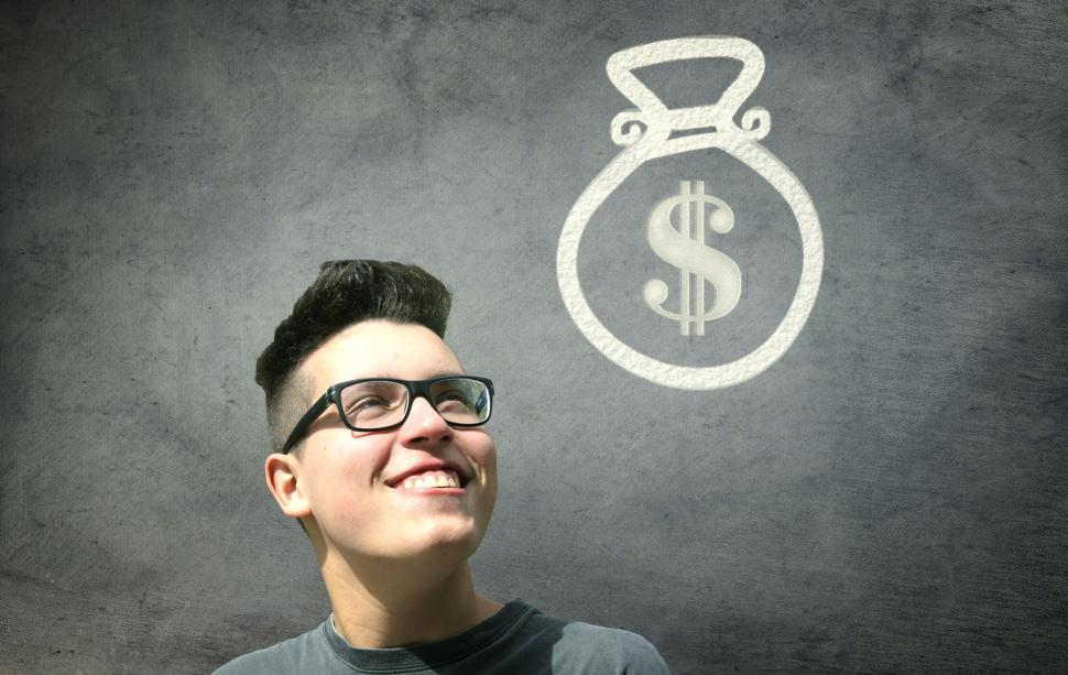 Download Free Stock Photo of Prize Winner - Young Man Smiling with Bag of Money