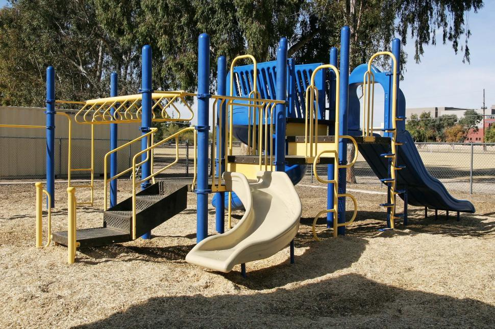 Download Free Stock Photo of playground school jungle gym monkey bars slides climb ladders steps sawdust