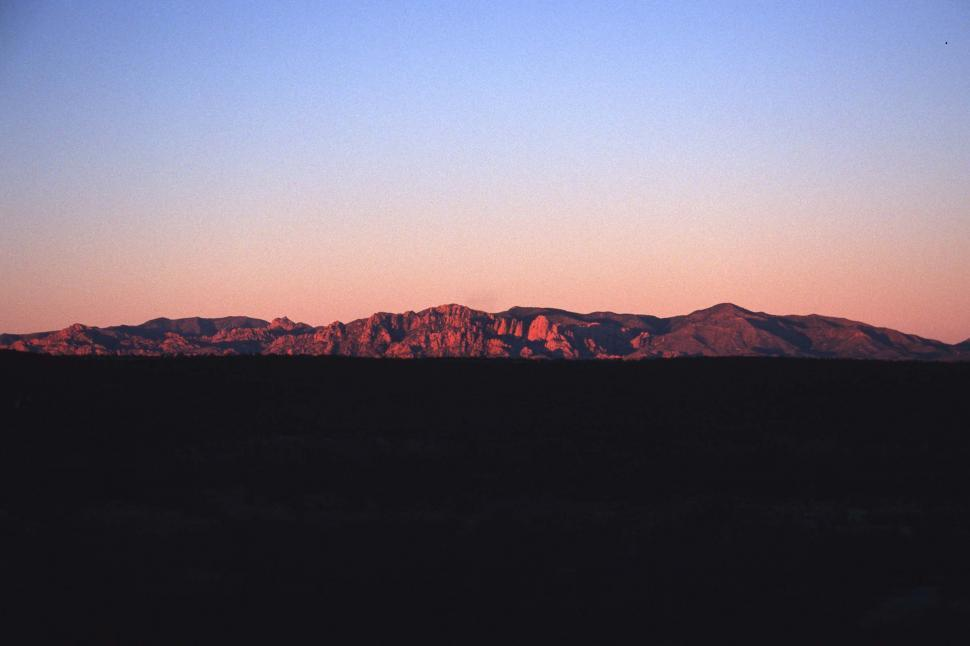 Download Free Stock HD Photo of Warm light on distant mountains Online