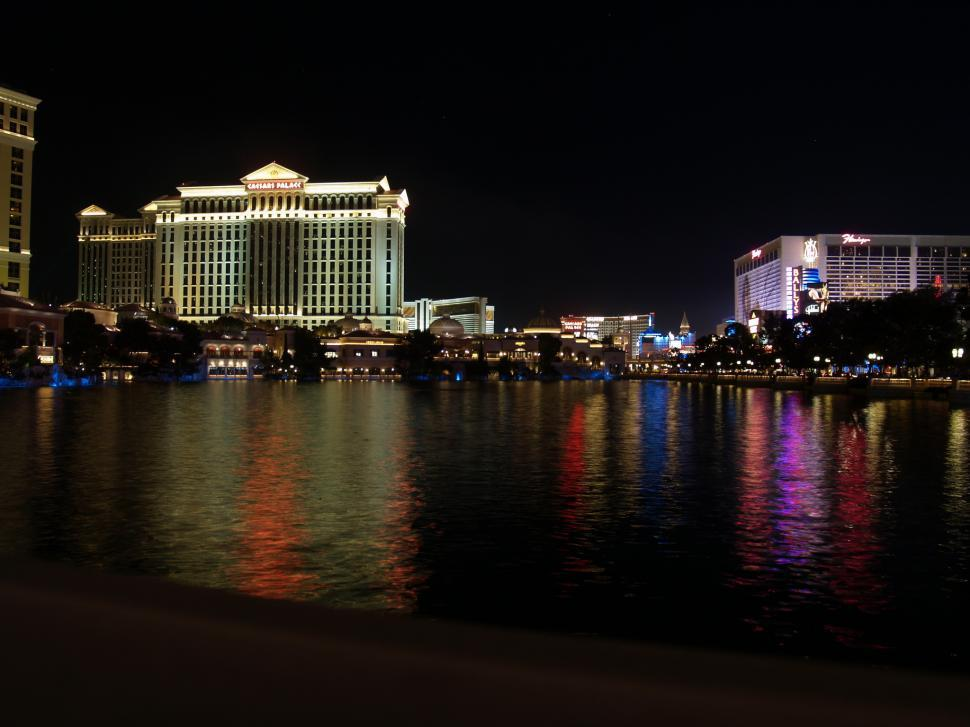 Download Free Stock HD Photo of night skyline in Las Vegas over water Online