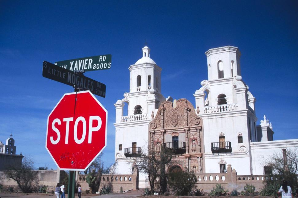 Download Free Stock HD Photo of Street sign and Mission San Xavier del Bac Online