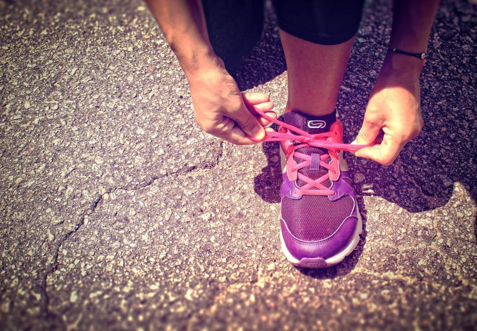 Download Free Stock HD Photo of Running Shoes - Woman Tying Shoe Laces - Women Health and Fitnes Online