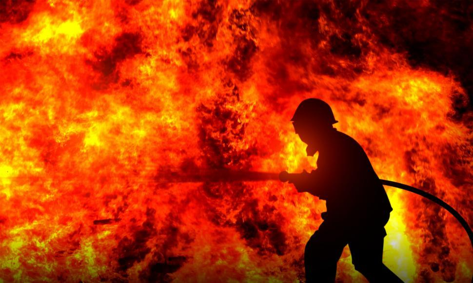 Download Free Stock Photo of Firefighter Fighting a Raging Wildfire - Silhouette