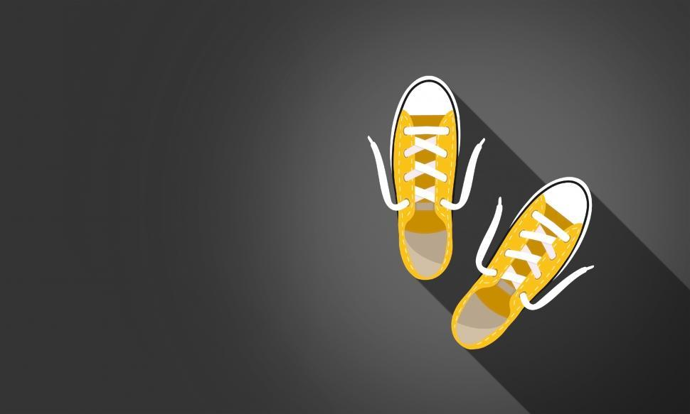 Download Free Stock HD Photo of Yellow Sneakers on Dark Background - With Copyspace Online