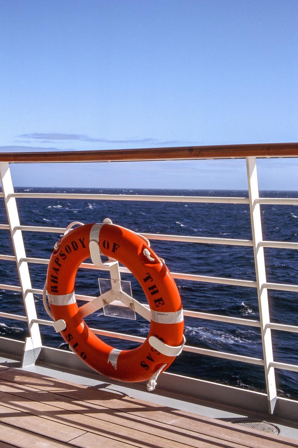 Download Free Stock HD Photo of Orange lifesaver ring Online