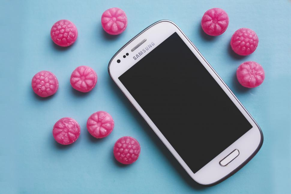 Download Free Stock Photo of Galaxy SIII Mini Pink candy samsung screen smartphone sugar technology touchscreen white technology