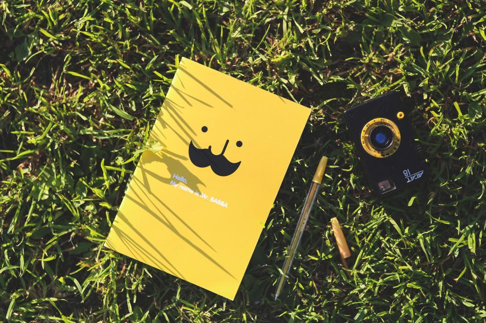Download Free Stock Photo of camera funny pen school yellow mustache notebook shelter protective covering