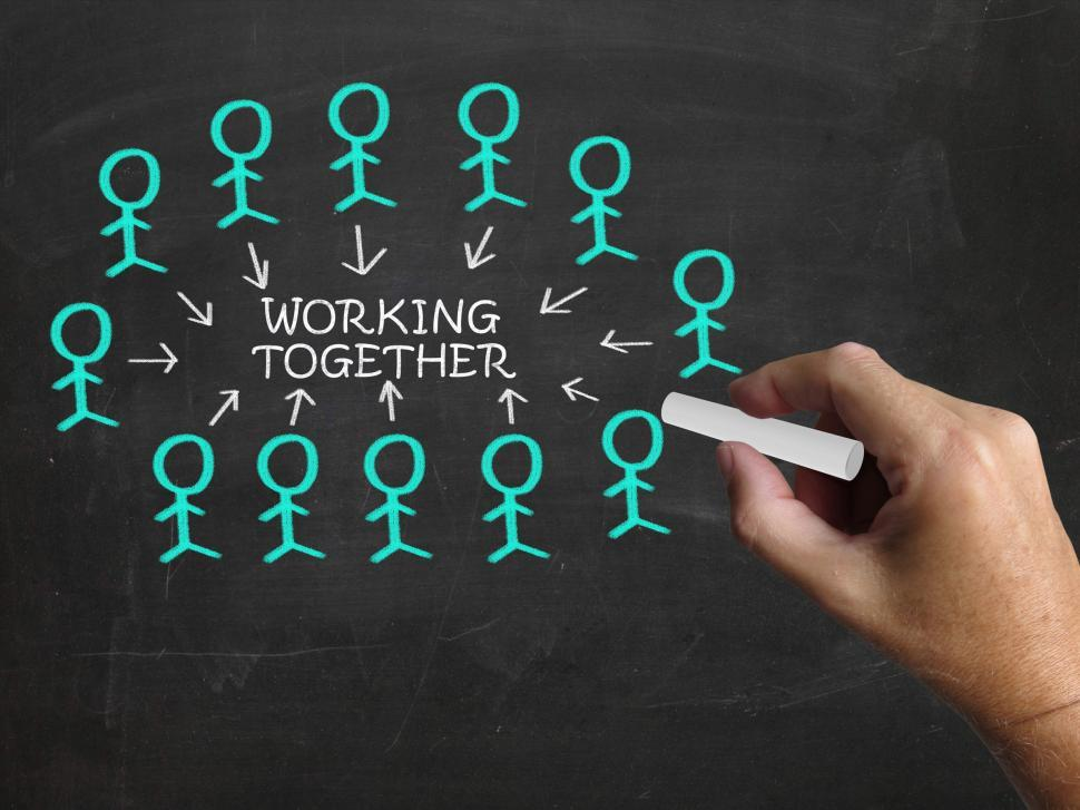 Download Free Stock HD Photo of Working Together On Blackboard Means Teamwork And Unity Online