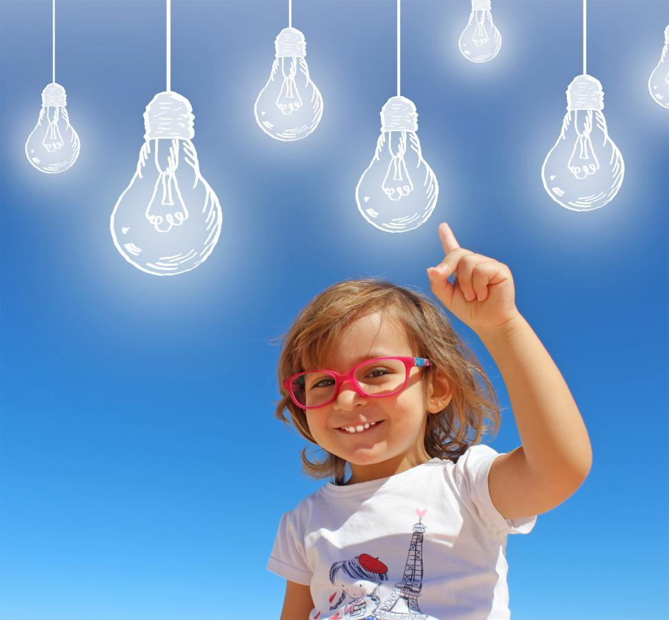 Download Free Stock Photo of Cheerful Smiling Child Having Ideas - Creativity and Imagination