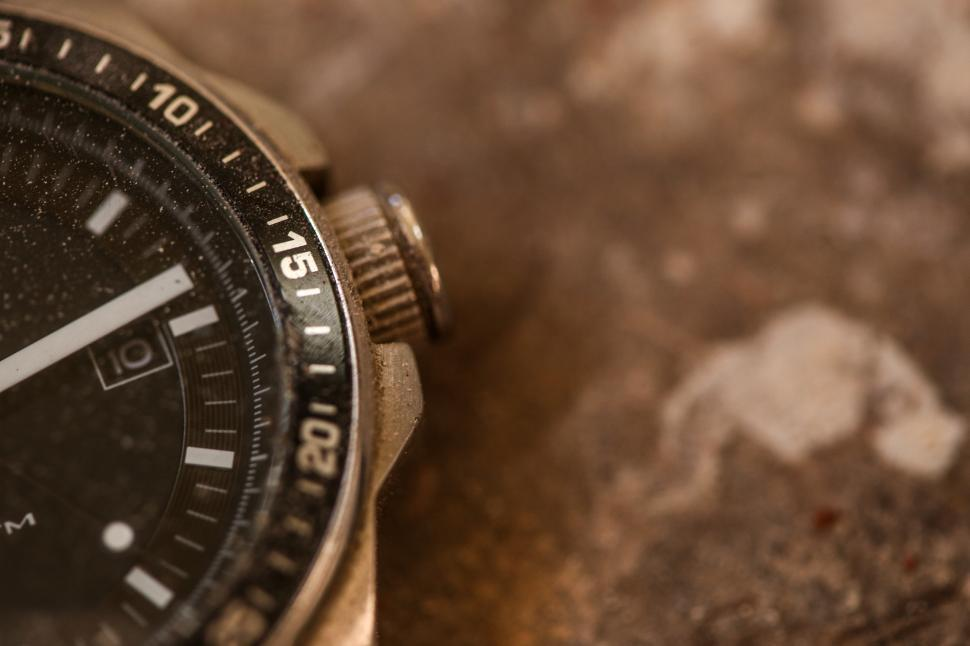 Download Free Stock HD Photo of Watch in the dirt Online