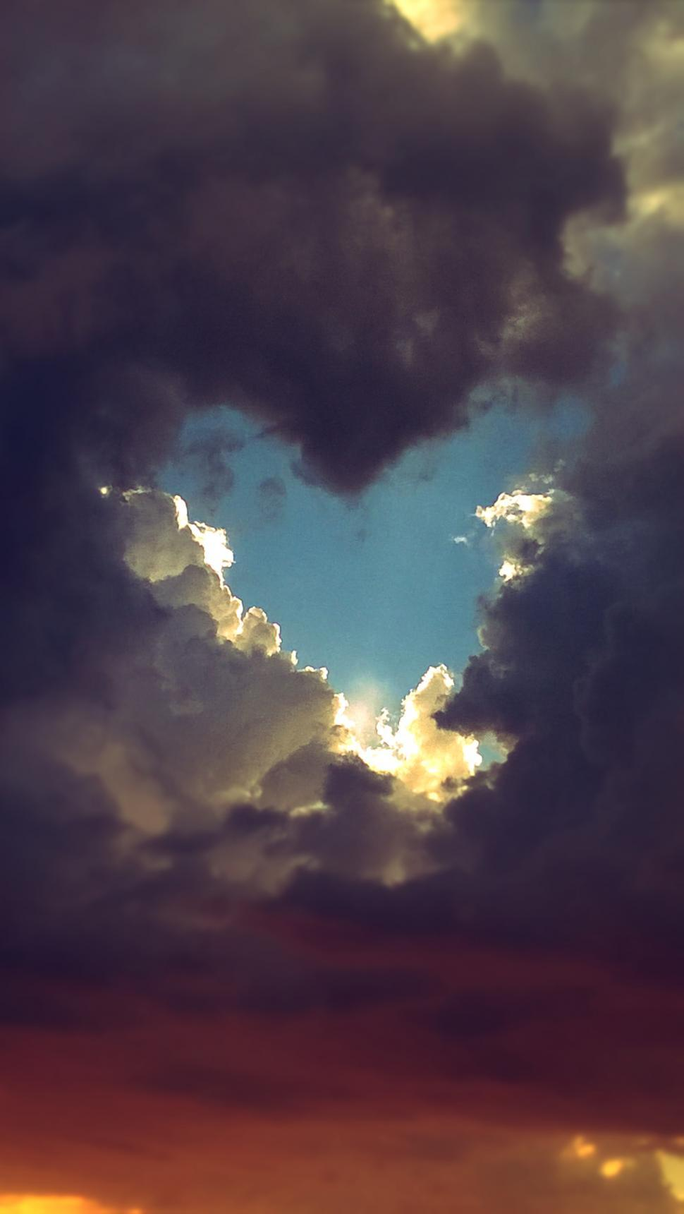 Download Free Stock HD Photo of Heart Shaped Break in the Clouds  Online