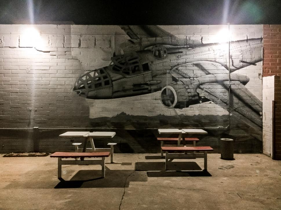 Download Free Stock Photo of Outdoor seating with mural