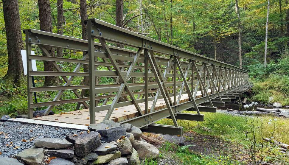 Download Free Stock HD Photo of Metal Frame Foot Bridge Over a Creek Online