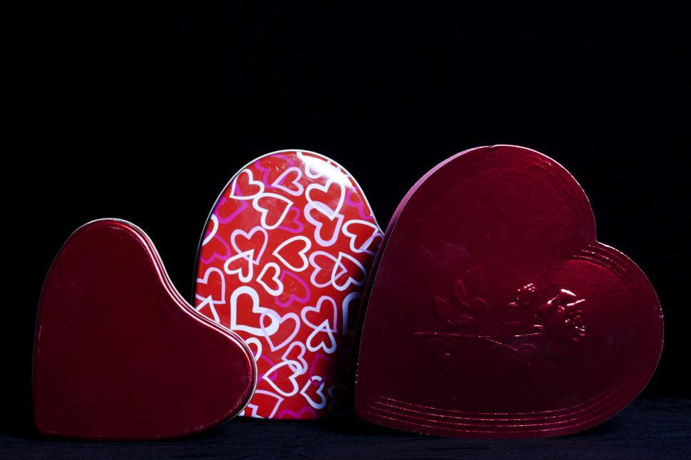 Download Free Stock HD Photo of Heart Shaped Gift Boxes on Black Online
