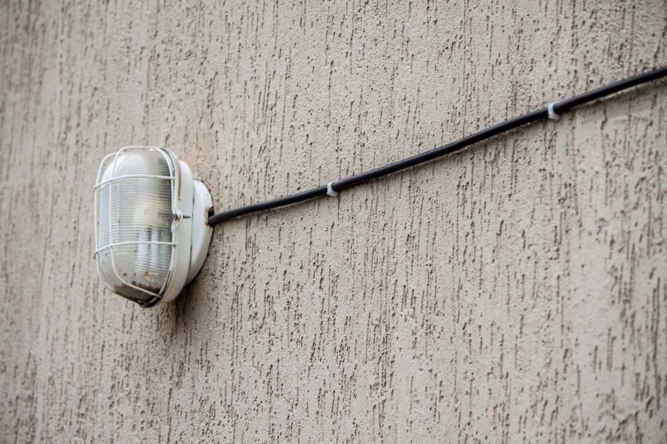 Download Free Stock HD Photo of Rusty exterior light and cable Online