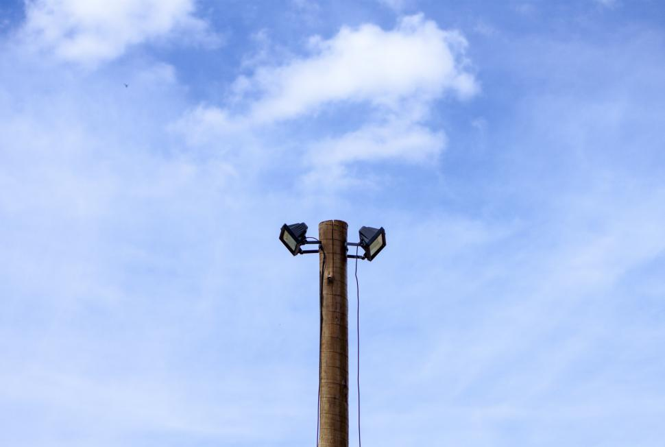 Download Free Stock Photo of Two spotlights atop a wooden post