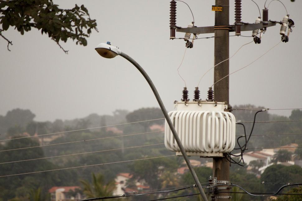 Download Free Stock Photo of A streetlight and transformer post in the rain