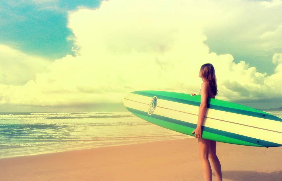 Download Free Stock Photo of Up to the Challenge - Woman with Surfboard ready to Surf - Vinta
