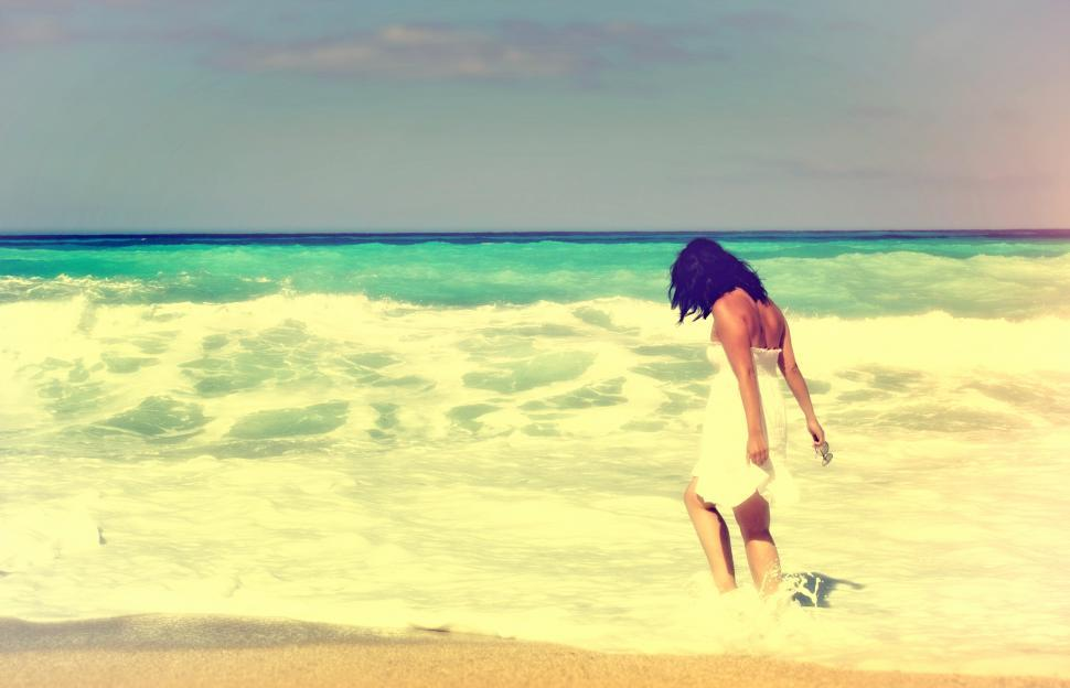 Download Free Stock Photo of Woman Walking Alone on the Beach - Vintage Looks