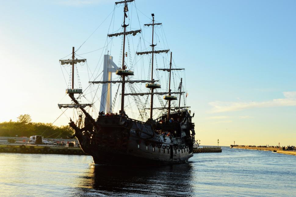Download Free Stock HD Photo of Tourist old sailing ship Galleon enters the harbor after an excursion or trip in the sea. The Baltic Sea Online