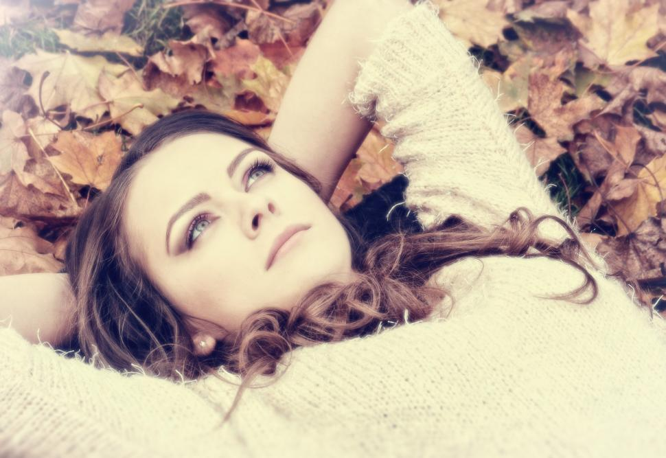 Download Free Stock Photo of Portrait of Dreamy Woman on Autumn Leaves