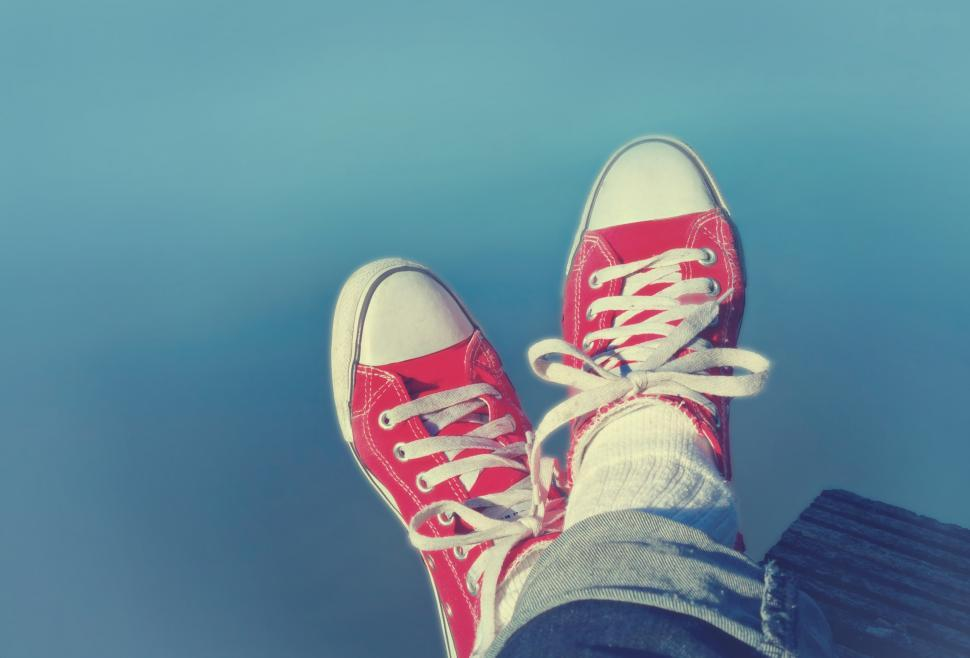 Download Free Stock HD Photo of Feet Crossed - Relaxation and Satisfaction - Red Sneakers Online