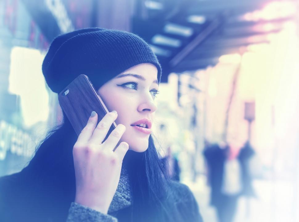 Download Free Stock Photo of Woman Talking Through Smartphone