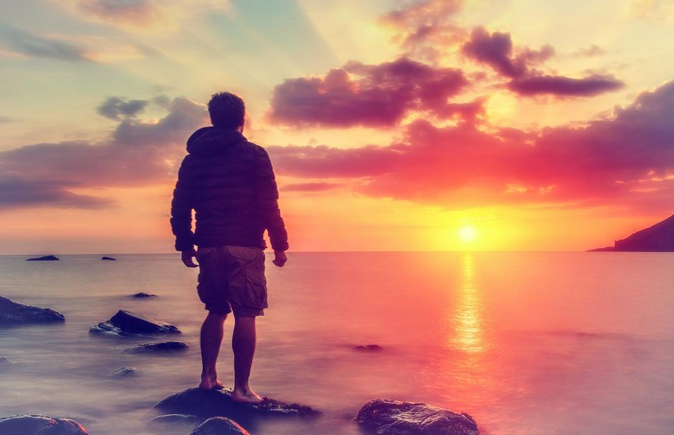 Download Free Stock Photo of Young Man Watching the Sunrise at Rocky Beach