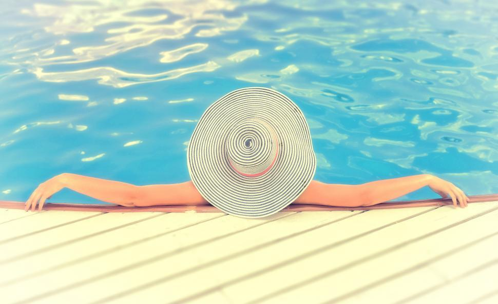 Download Free Stock Photo of Woman on Vacations with Hat Relaxing -Swimming Pool