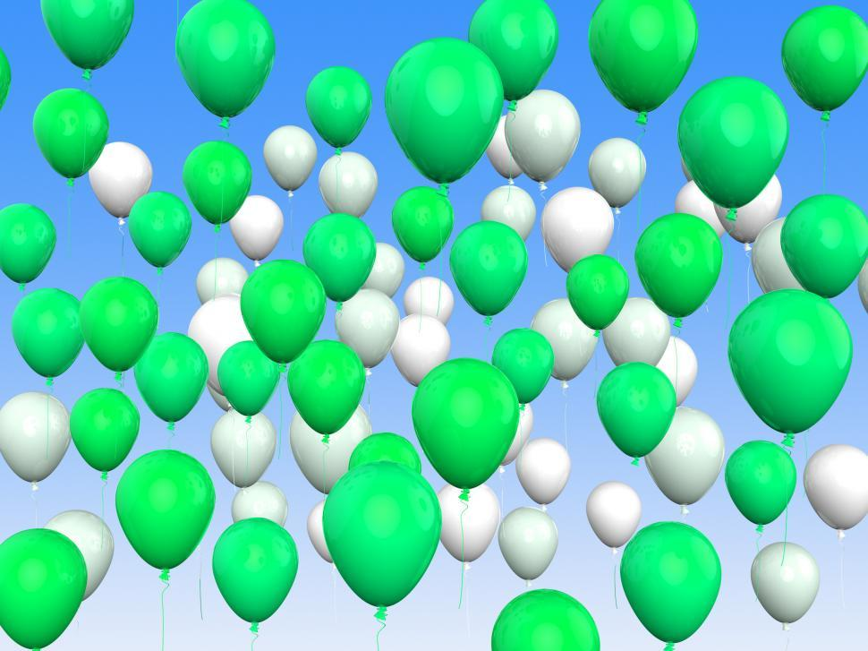 Download Free Stock HD Photo of Floating Green And White Balloons Mean Freedom And Eco Friendly Online