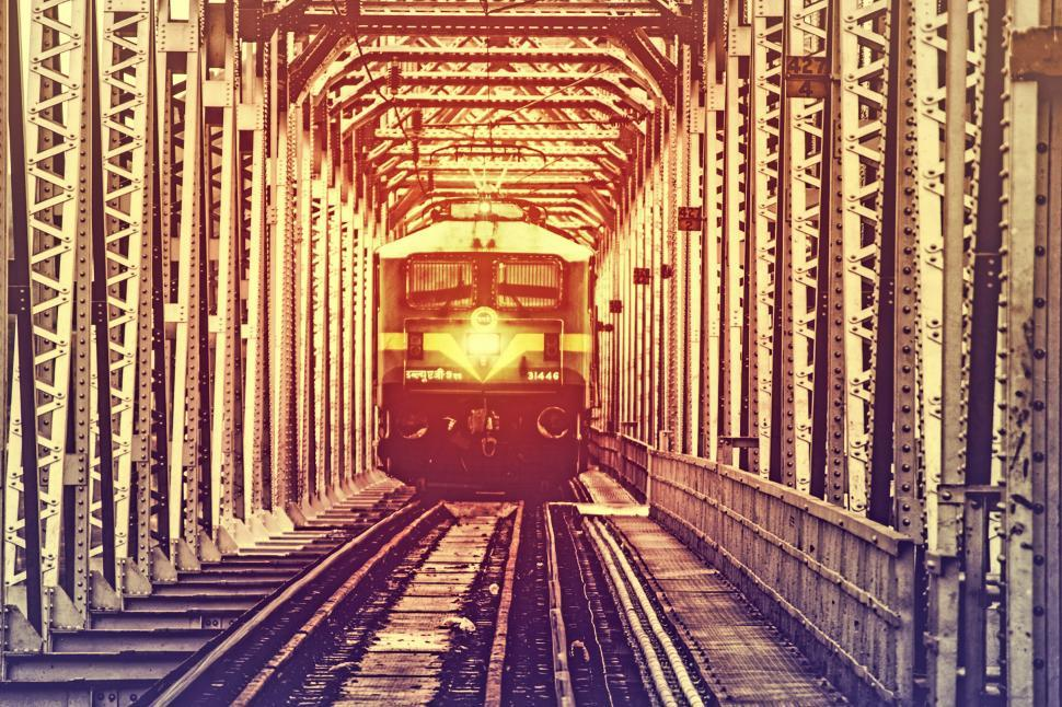 Download Free Stock Photo of Train Crossing Metal Bridge
