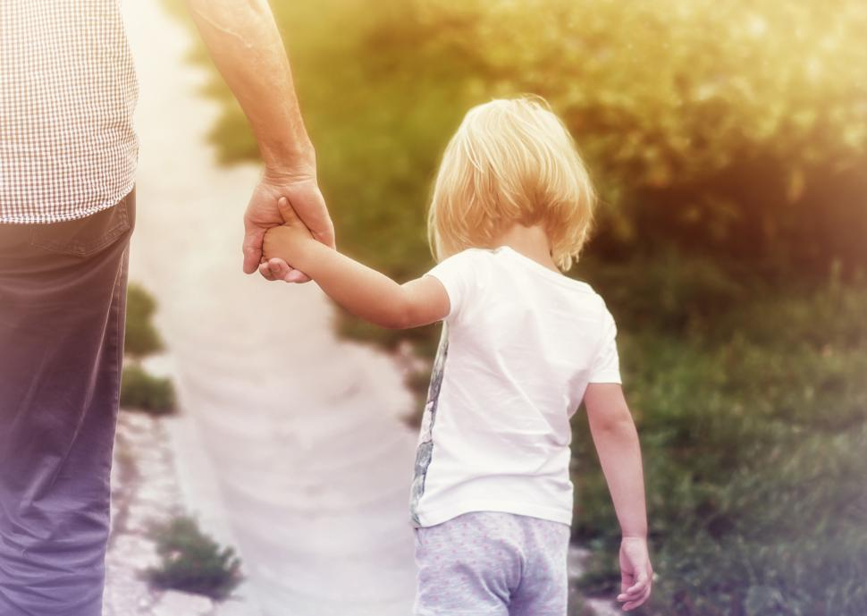Download Free Stock HD Photo of Father Holding Hands with Little Daughter Online