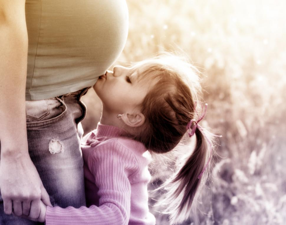 Download Free Stock HD Photo of Little Blonde Girl Kissing Belly of Pregnant Mother Online