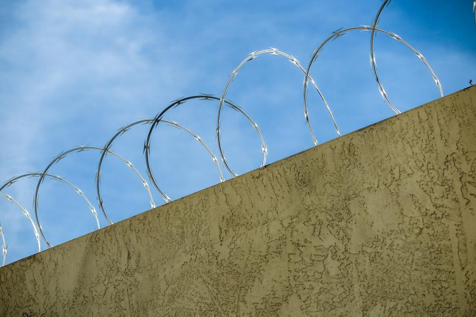 Download Free Stock HD Photo of Razor wire in top of wall Online
