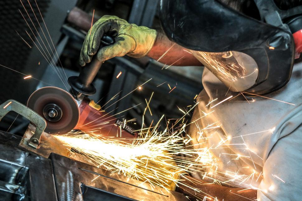 Download Free Stock HD Photo of Grinding steel as sparks fly Online