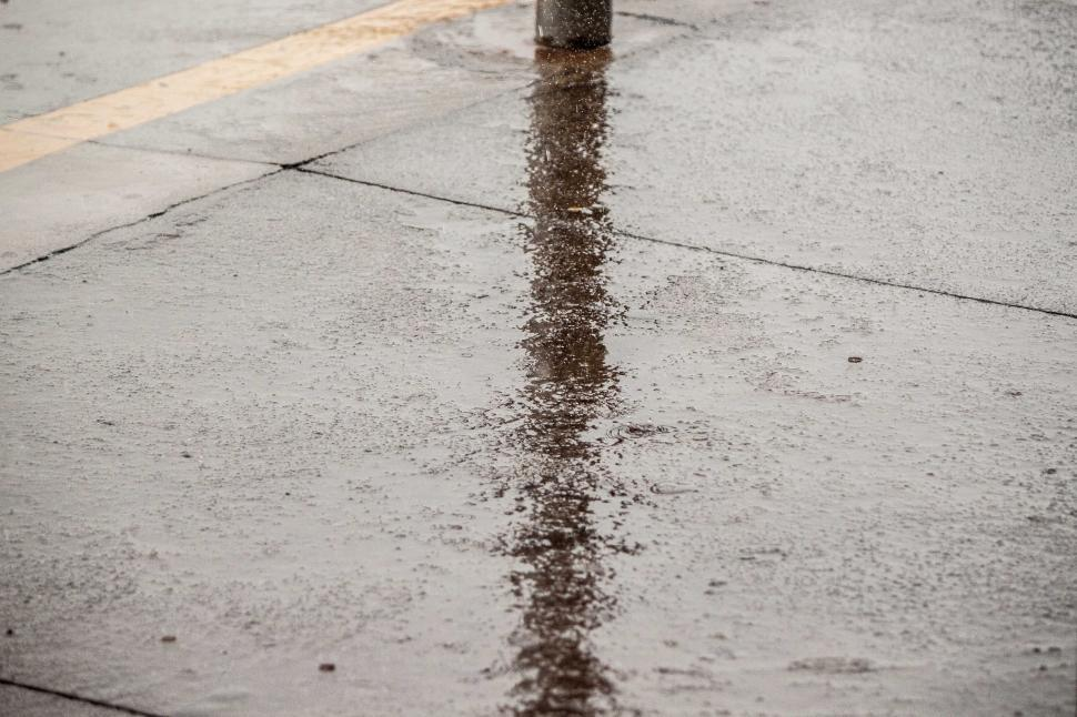 Download Free Stock Photo of Lamp post reflection on rainy ground