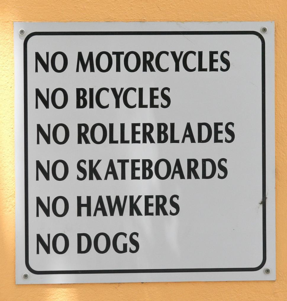 Download Free Stock Photo of sign no dogs no hawkers skateboards rollerblades bicycles motorcycles no