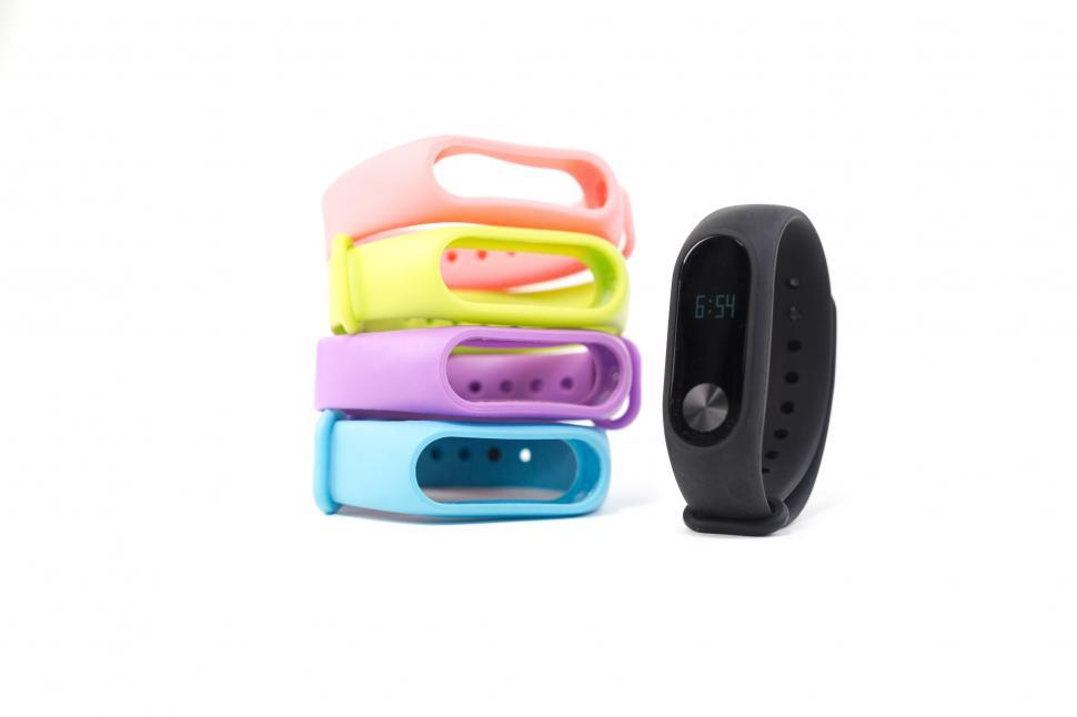 Download Free Stock Photo of Colorful Fitness Trackers