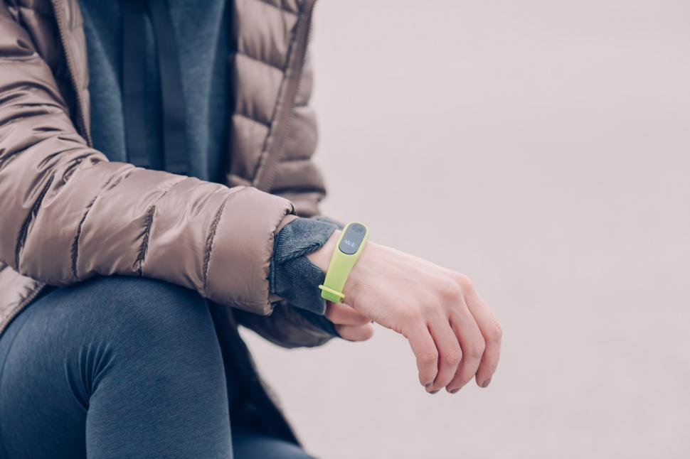 Download Free Stock HD Photo of Runner Wearing Fitness Tracker Watch Online