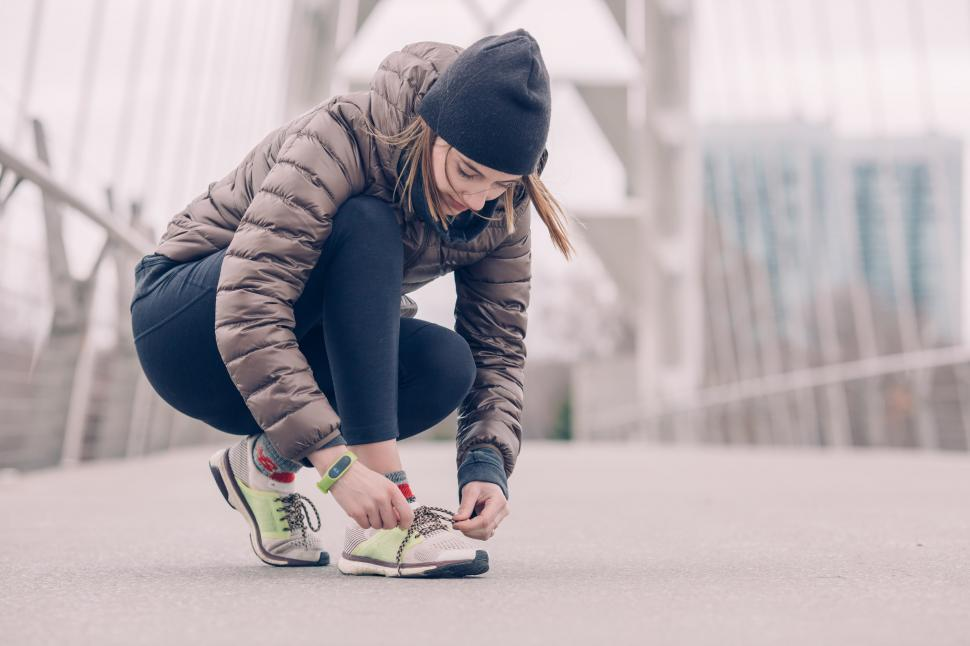 Download Free Stock HD Photo of Female Athlete Tying Her Shoes Online