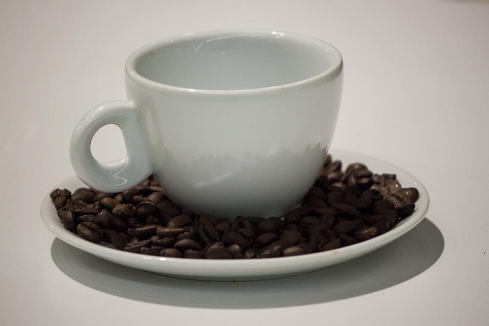 Download Free Stock Photo of White coffee cup and beans