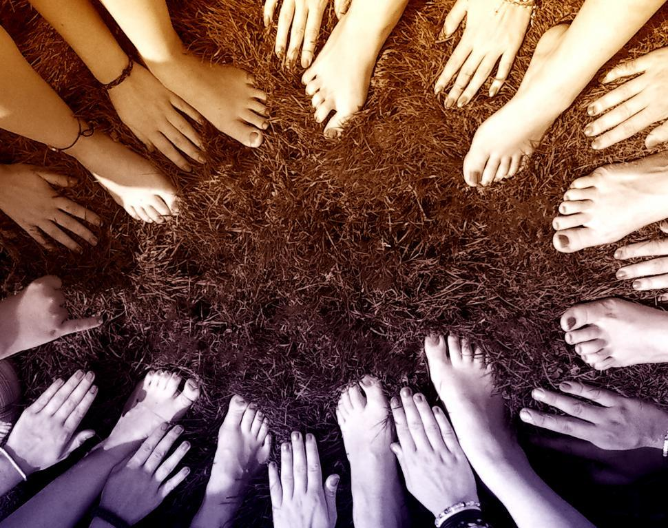 Download Free Stock Photo of All Together - People Joining Hands and Feet in a Circle