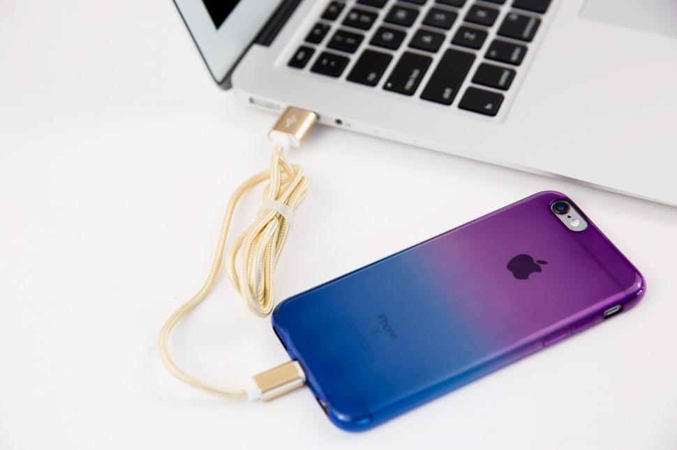Download Free Stock HD Photo of Smartphone charging with laptop Online