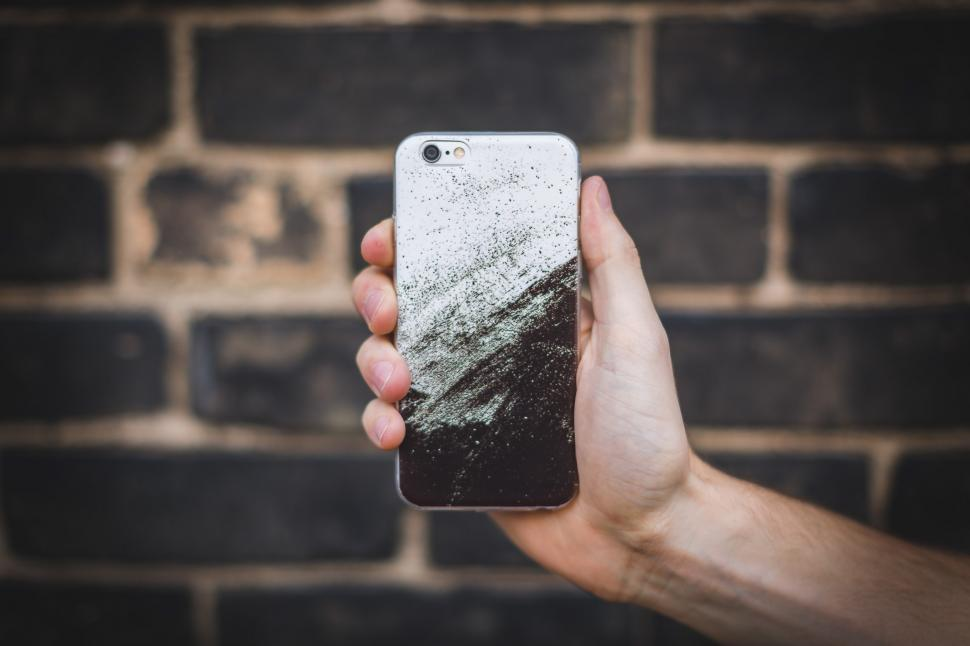 Download Free Stock HD Photo of Holding iPhone 6 Online