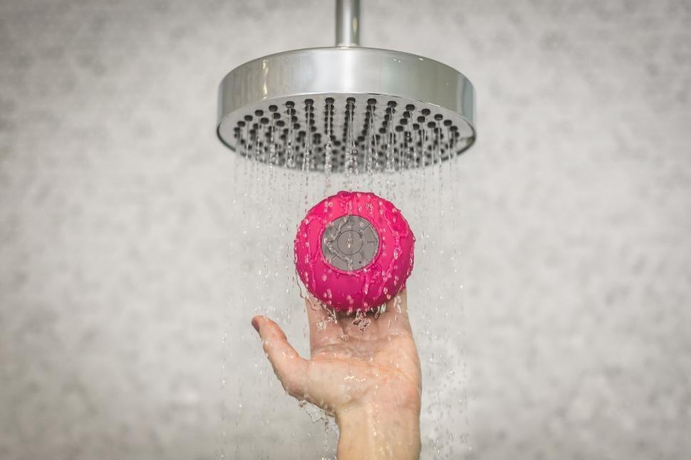 Download Free Stock HD Photo of Holding Shower Speaker Online